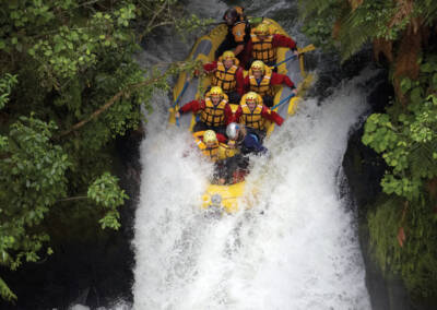 Rafting the 7 metre Tutea falls on the Kaituna River, Rotorua, New Zealand